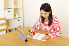 Asian woman copy from digital tablet Stock Image