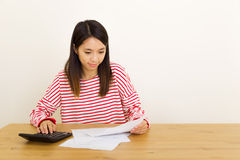 Asian woman counting the expenditure Royalty Free Stock Photo