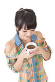 Asian woman with cup of coffee or tea. Royalty Free Stock Image