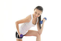 Asian woman curling weights. Beautiful Asian woman curling hand weights Stock Images