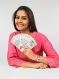 Asian woman with currency notes Royalty Free Stock Photos