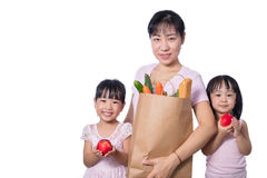 Asian Woman and daughters carrying groceries Stock Photography