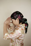 Asian woman in deep thought Royalty Free Stock Image
