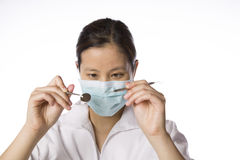 Asian woman dentist isolated against white Stock Image
