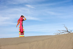 Asian woman in desert. Royalty Free Stock Images