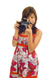 Asian woman with a digital camera Stock Image