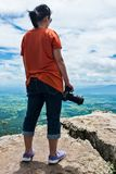 Asian woman with digital camera, outdoor at the daytime on summe. Full body of asian woman with digital camera at view point on the top of mountain, travel on Stock Photo