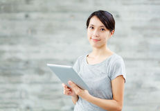 Asian woman with digital tablet. At outdoor Stock Photography
