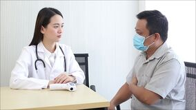 Asian woman doctor work and look at the report of patient in hospital