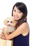 Asian woman with dog poodle Royalty Free Stock Photo