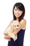 Asian woman with dog poodle Royalty Free Stock Image