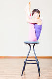 Asian woman doing exercise or yoga at home at chair Royalty Free Stock Photo