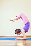 Asian woman doing exercise of yoga at mat Royalty Free Stock Images
