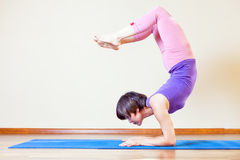 Asian woman doing exercise of yoga at mat Stock Images