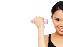Asian woman doing exercises. Cropped view head portarit of an attractive Asian woman doing exercises with a dumbbell in her hand isolated on white Royalty Free Stock Photography