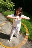 Asian woman doing hula hoop Stock Images