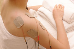Asian woman is doing massage of electrical -stimulation ( TENs ) Stock Photography
