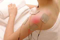 Asian woman is doing massage of electrical -stimulation ( TENs ) stock image