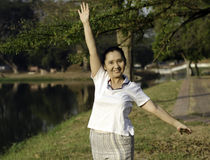 Woman doing morning exercises in the park Royalty Free Stock Photos