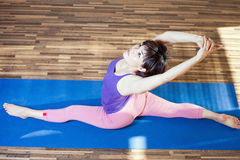 Asian woman doing splits for yoga exercise indoor Royalty Free Stock Photos