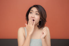 Asian woman doing surprised face Stock Photos