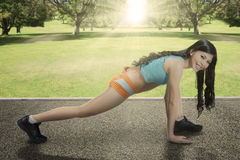 Asian woman doing workout at park Stock Photography