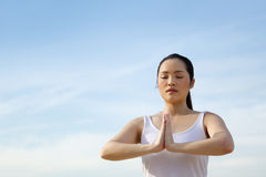Asian woman doing yoga. Royalty Free Stock Image