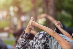 Asian woman doing yoga or exercise in the park Stock Photography