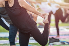Asian woman doing yoga or exercise in the park Royalty Free Stock Photos