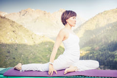 Asian woman doing yoga at mountain Royalty Free Stock Images