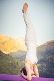 Asian woman doing yoga at mountain Stock Images