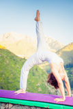 Asian woman doing yoga at mountain Stock Photos