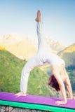 Asian woman doing yoga at mountain Stock Photos