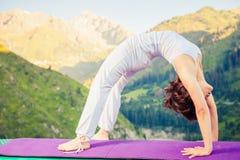 Asian woman doing yoga at mountain Stock Photo