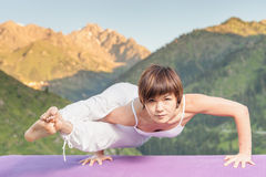 Asian woman doing yoga at mountain Stock Images