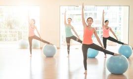 Asian woman Doing Yoga In yoga studio royalty free stock photos