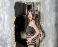 Asian woman in doorway Stock Photography