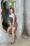 Asian woman in doorway. Chinese woman in doorway of abandoned building Stock Image