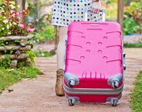 Asian woman dragging a suitcase Stock Photography
