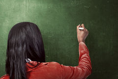 Asian woman drawing something on the blackboard Stock Photo