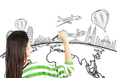 Asian woman drawing or writing dream travel around the world. On white stock image