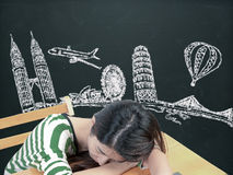 Asian woman dreaming and thinking travel holidays on blackboard. Asian woman dreaming and thinking travel  holidays on blackboard Royalty Free Stock Photo