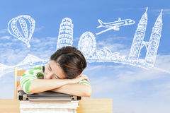 Asian woman dreaming about travel and holiday Royalty Free Stock Image