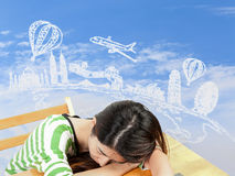 Asian woman dreaming about travel and holiday Royalty Free Stock Photo