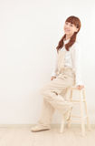 Asian woman dressed in overalls with empty space Stock Images