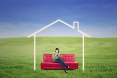 Asian woman drink coffee in dream house outdoor Royalty Free Stock Photography