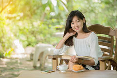 Asian woman drink coffee Royalty Free Stock Photography