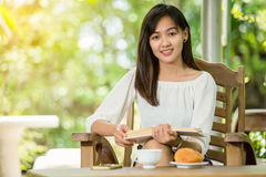 Asian woman drink coffee Stock Photography