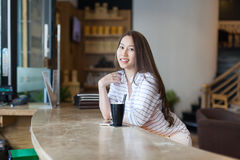 Asian woman drink ice coffee sitting cafe shop Stock Photo