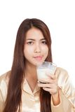 Asian woman drink milk  licking her lip Royalty Free Stock Images